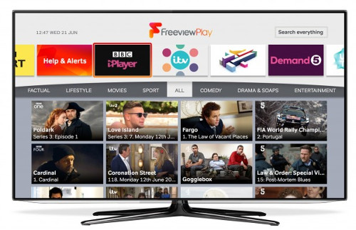 Freeview Explore: UHD 4K Smart TV standing on white background. Front view. There is 4K Logo on the display.